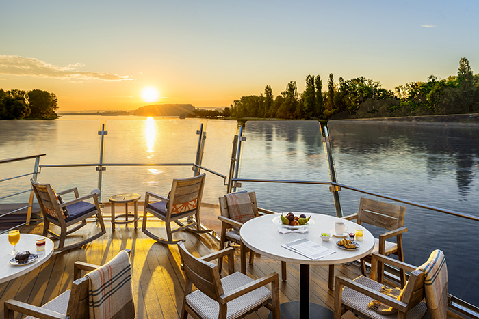 Aquavit Terrace at dawn with breakfast on the table onboard the Viking Longship Hlin in the Upper Middle Rhine Valley in Germany